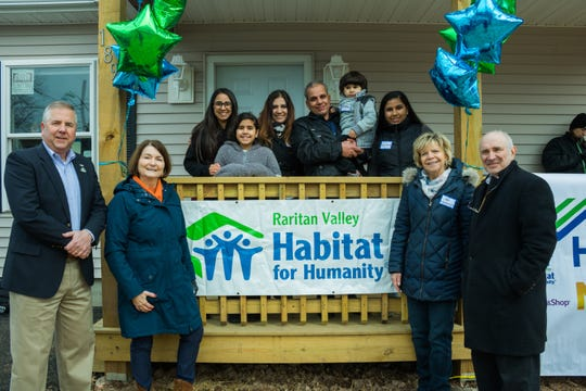 (from left to right) Somerset County Freeholder Brian Gallagher, Raritan Valley Habitat for Humanity (RVHFH) Board President Meg Helms, The Wadie Family, RVHFH Executive Director Jan Holmstrup and Franklin Township Mayor Phillip Kramer, gather in front of the home the Wadie Family built with the help of the community at their home dedication ceremony on Saturday, Feb. 23.