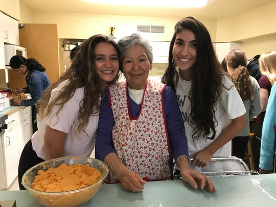 Wardlaw+Hartridge students Judy Minnium and Camila Martinez, both of Scotch Plains, learn to make gorditas in the Southwestern style.