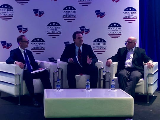 Democratic Montana Gov. Steve Bullock and Republican Maryland Gov. Larry Hogan participate in a conversation at the National Governors Association regional workshop in Des Moines March 4, 2019.