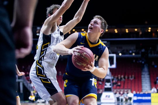 Regina's Luke Stein looks to shoot during the IHSAA state basketball Class 2A quarterfinal between Boyden-Hull and Iowa City Regina on Monday, March 4, 2019, in Wells Fargo Arena.