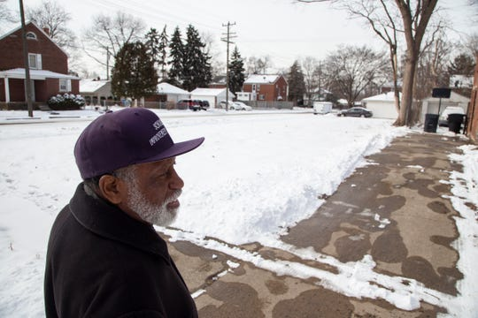 Aaron Slaughter, who is part of the Schoolcraft Improvement Association, speaks about the changes he has seen in his Detroit neighborhood, Thursday, Feb 28, 2019 as he stands near a lot where a blighted house was removed.