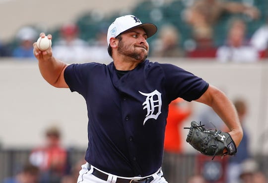 Tigers pitcher Michael Fulmer throws a pitch during the first inning on Monday, March 4, 2019, in Lakeland, Fla.