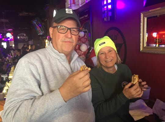 Chuck and Patti Judson of Ann Arbor enjoy the Pazcki Burger at Motor City Sports Bar and Grill in Hamtramck.
