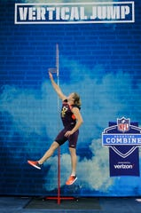 Mar 3, 2019; Indianapolis, IN, USA; Michigan defensive lineman Chase Winovich (DL52) does the vertical jump during the 2019 NFL Combine at Lucas Oil Stadium. Mandatory Credit: Brian Spurlock-USA TODAY Sports