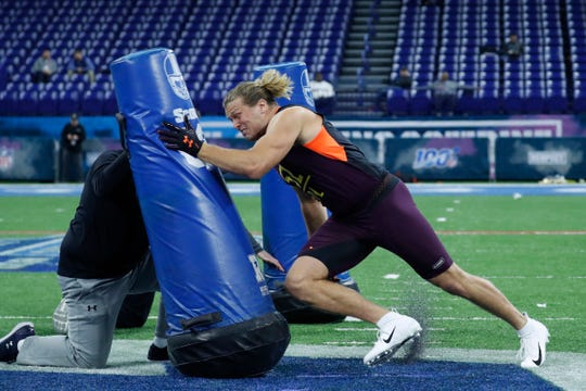 Michigan defensive lineman Chase Winovich goes through workout drills during the NFL combine at Lucas Oil Stadium, March 3, 2019.