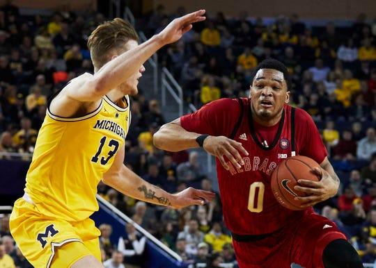 Nebraska guard James Palmer Jr. dribbles against Michigan forward Ignas Brazdeikis at Crisler Center on Thursday.