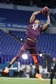 Michigan State cornerback Justin Layne runs a drill at the NFL scouting combine in Indianapolis, Monday, March 4, 2019.