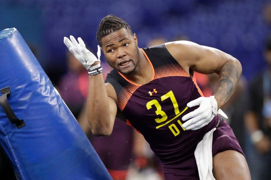 Michigan defensive lineman Rashan Gary runs a drill at the NFL scouting combine in Indianapolis, Sunday, March 3, 2019.