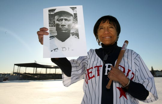 "Joyce Stearnes Thompson, 63, of Auburn Hills, holds a photo of her father Norman Thomas ""Turkey"" Stearnes, of the Detroit Stars at Veterans Park in Hamtramck, MI, Tuesday, February 22, 2011."