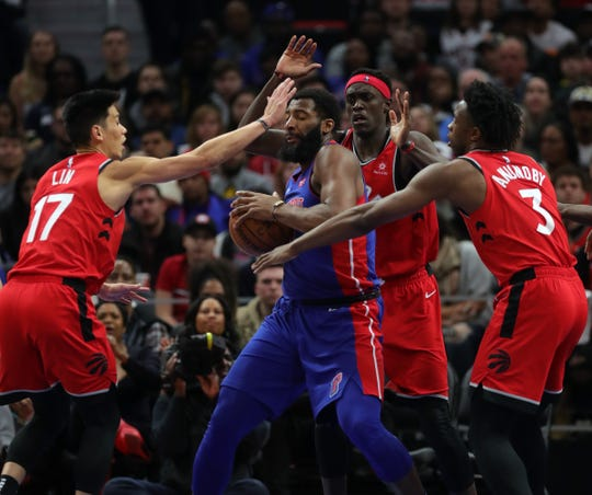 Andre Drummond rebounds against the Raptors during the fourth quarter Sunday at Little Caesars Arena.