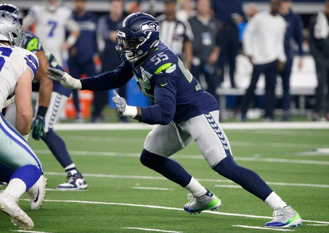 The Seattle Seahawks applied the franchise tag to defensive end Frank Clark (55), a former Michigan standout, on Monday.