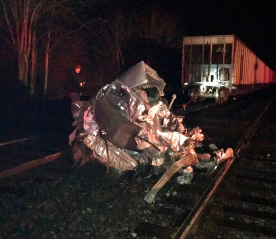 This photo provided by the Virginia State Police shows the site of a train crash in Fauquier County Sunday, March 3, 2019. Authorities say two trains hit a car stuck on tracks in Virginia, but the four people inside the car escaped before it was hit.