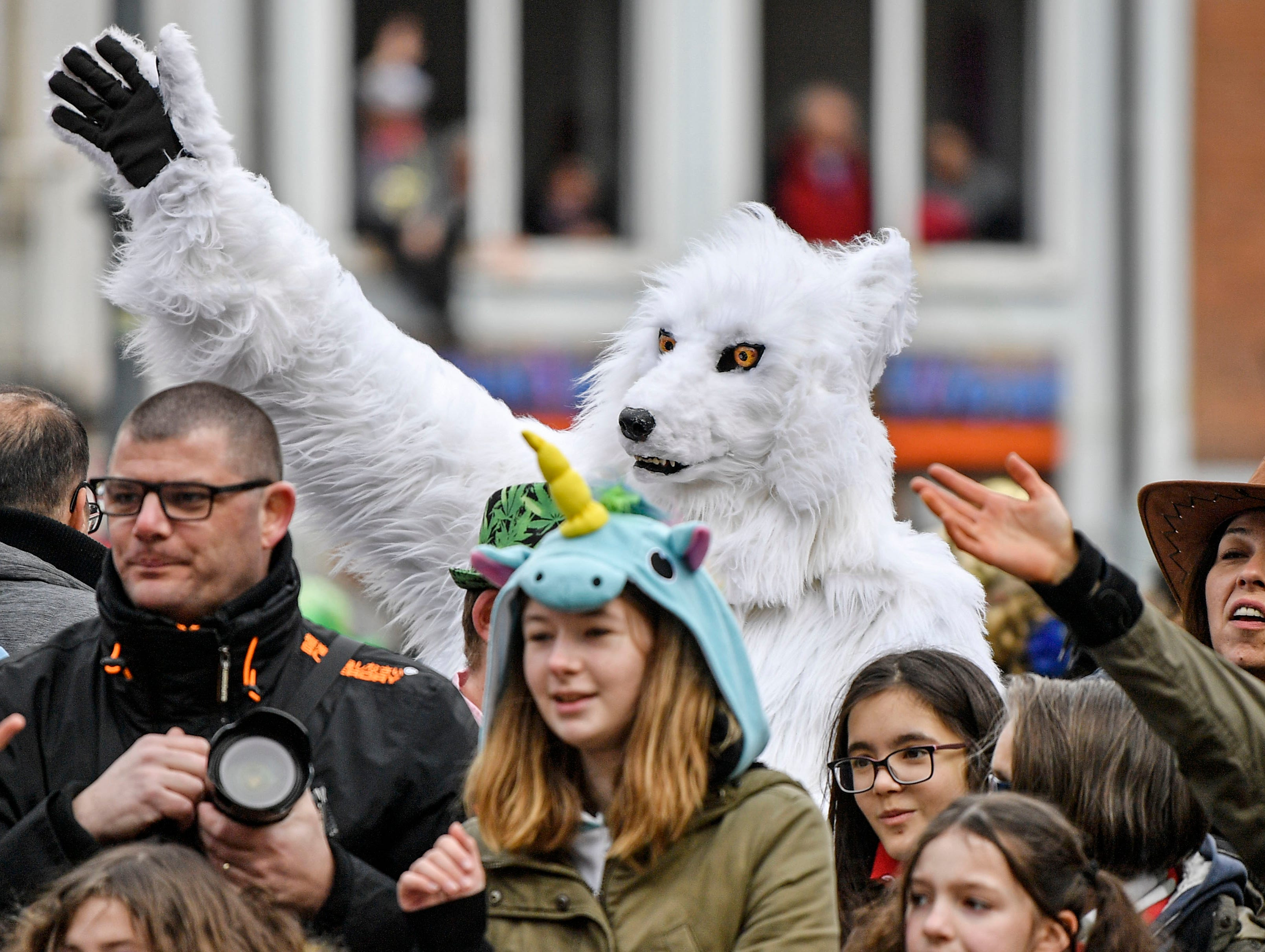 A reveler dressed as a white wolf begs for sweets during the traditional carnival parade in Duesseldorf, Germany, on Monday, March 4, 2019. The street spectacles in the carnival centers of Duesseldorf, Mainz and Cologne, watched by hundreds of thousands of people, are the highlights of Germany's carnival season on Rosemonday.