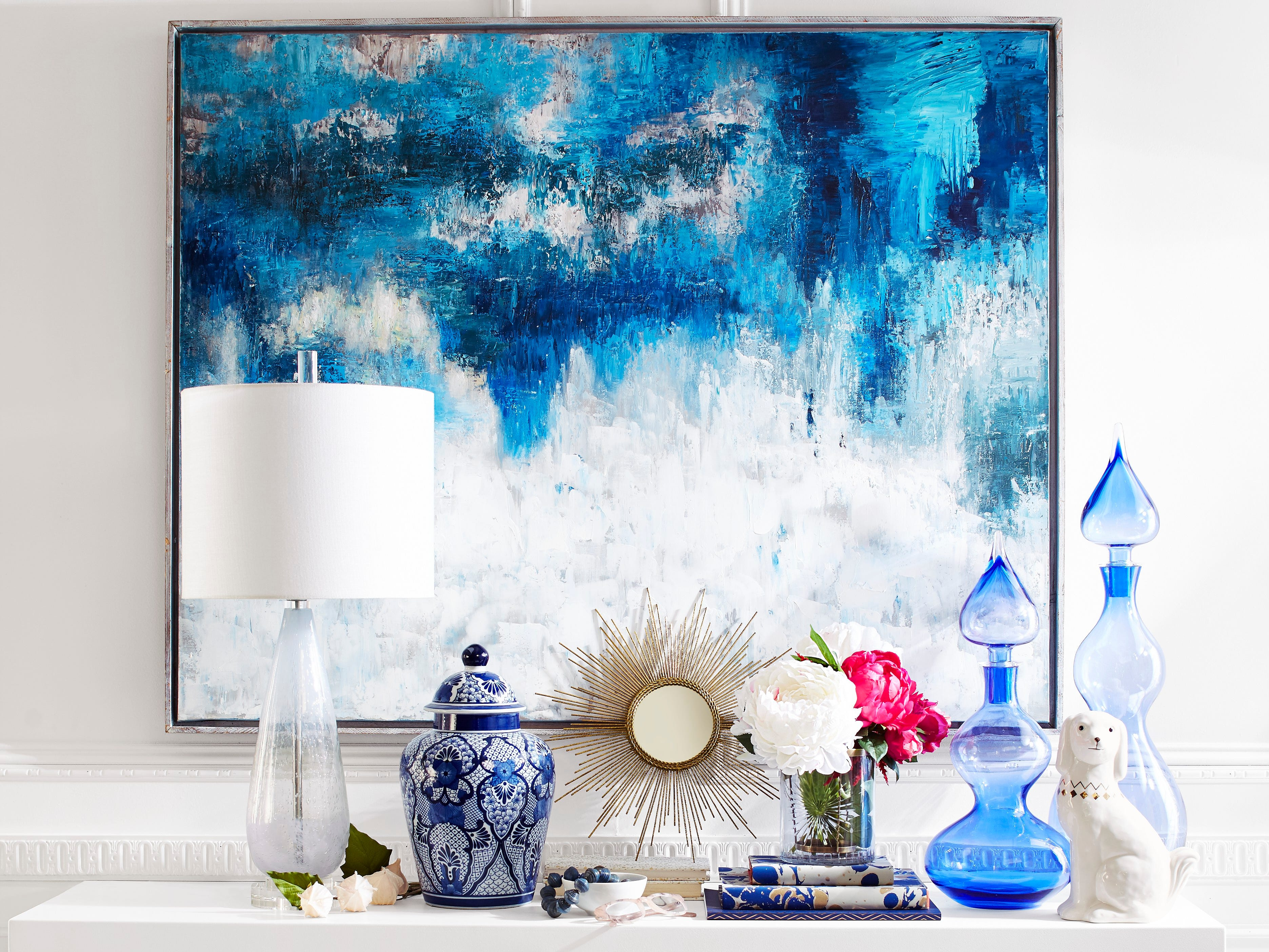 Give your favorite space a focal point with some color. Here, abstract art and accessories from Pier 1 Imports in shades of blue invigorate the room.
