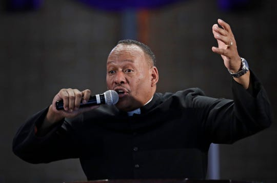Pastor Melvin Trent conducts a service at the New Beginnings Outreach Ministries, Sunday, March 3, in Youngstown, Ohio. Trent stood before about 150 members of his church in early February and told them he was leaving. His wife, an engineer with GM, was being sent to its SUV plant in Arlington, Texas.