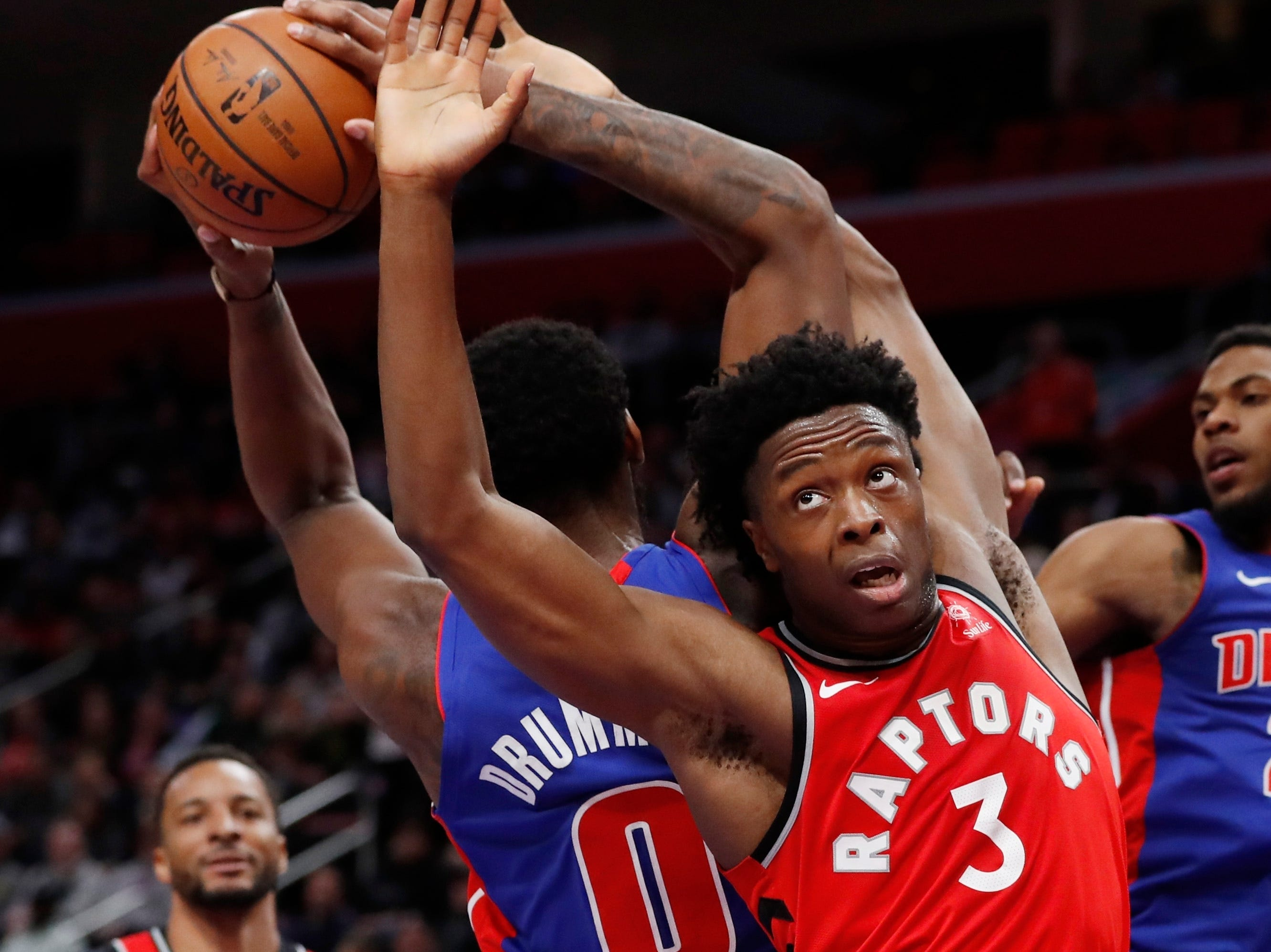 Detroit Pistons center Andre Drummond (0) grabs a rebound next to Toronto Raptors forward OG Anunoby (3) during the second half.
