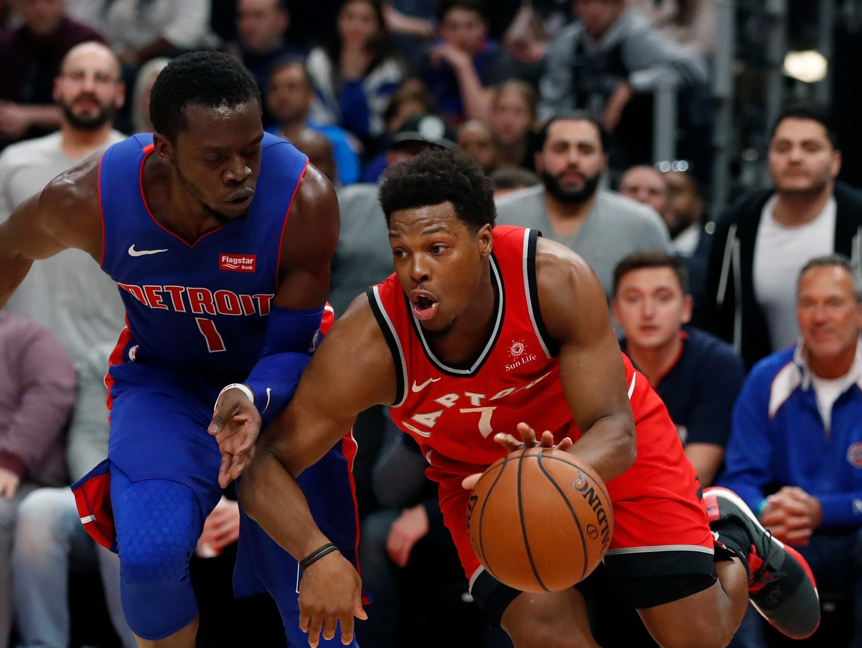 Toronto Raptors guard Kyle Lowry (7) drives on Detroit Pistons guard Reggie Jackson (1) during the second half.
