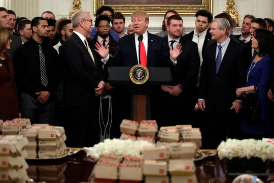 President Donald Trump welcomes 2018 NCAA FCS college football champion North Dakota State to the State Dining room of the White House in Washington on Monday.
