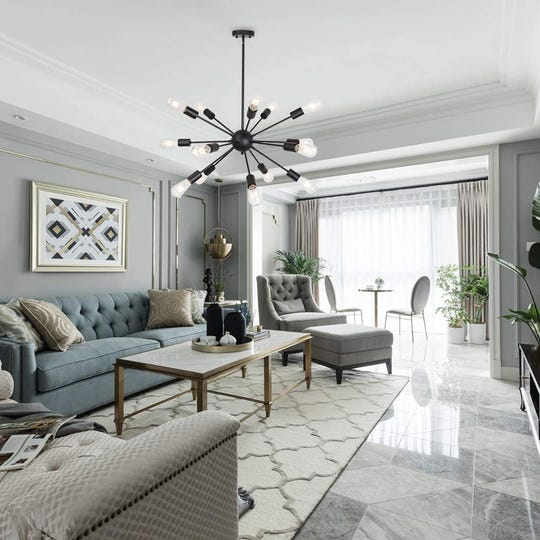 A chandelier can brighten any space while providing a decorative element that makes you want to linger like this 15 Lights Sputnik Chandeliers Mid Century Pendant Light Black available through houzz.com.