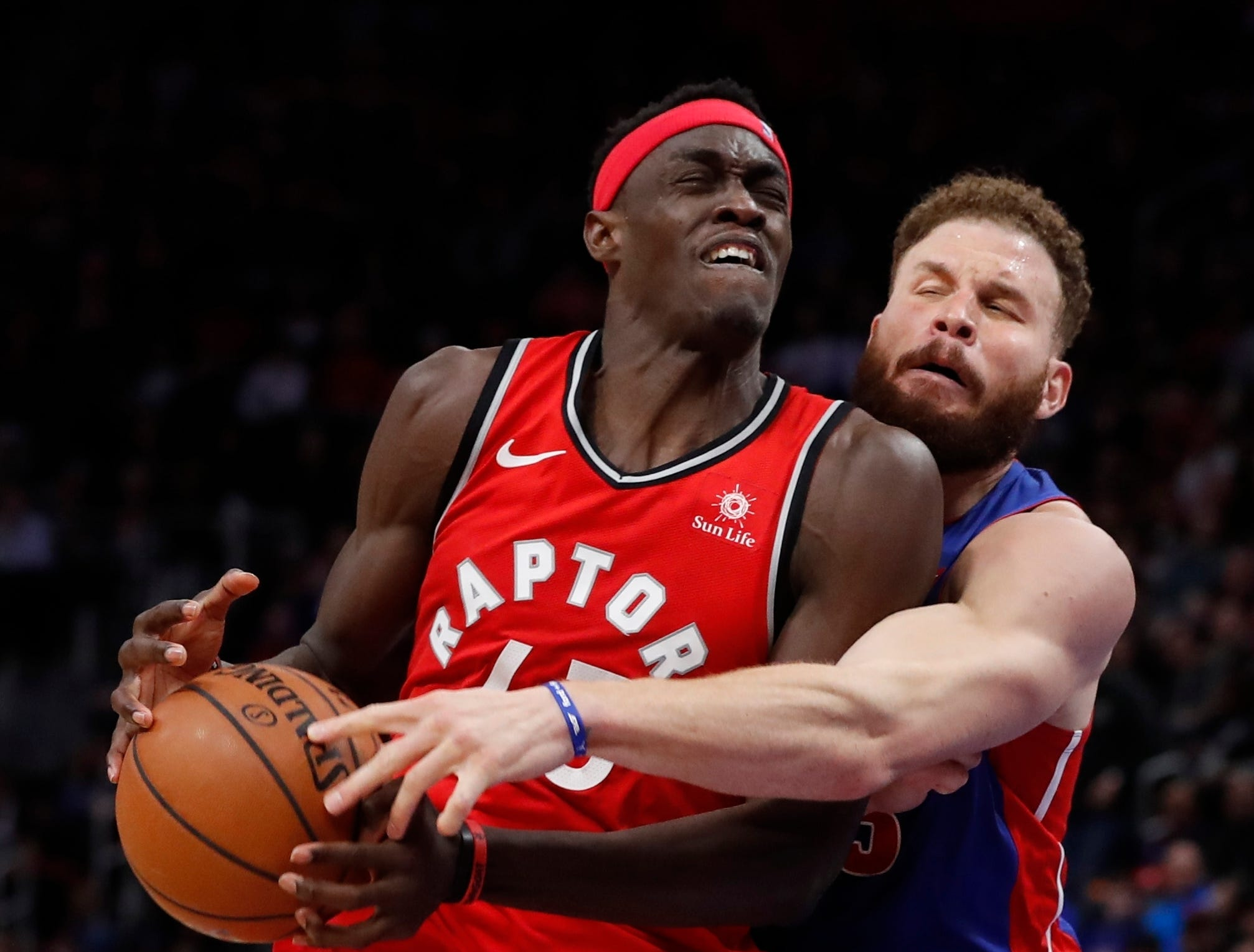 Detroit Pistons forward Blake Griffin knocks the ball away from Toronto Raptors forward Pascal Siakam during the second half.