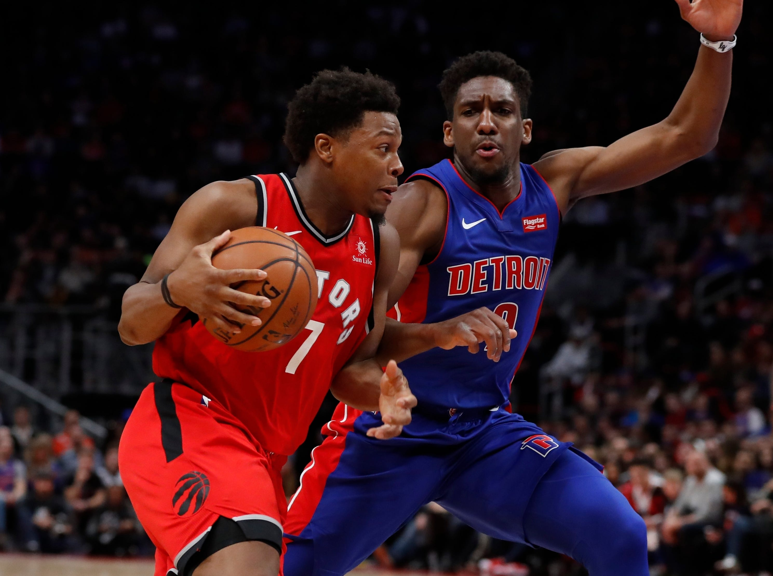 Toronto Raptors guard Kyle Lowry (7) drives on Detroit Pistons guard Langston Galloway (9) during the second half.