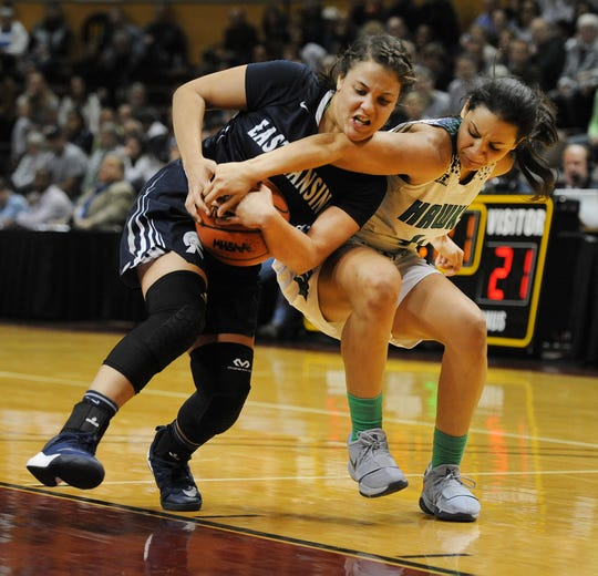 Michigan State-bound Moira Joiner (4), right, leads Saginaw Heritage.