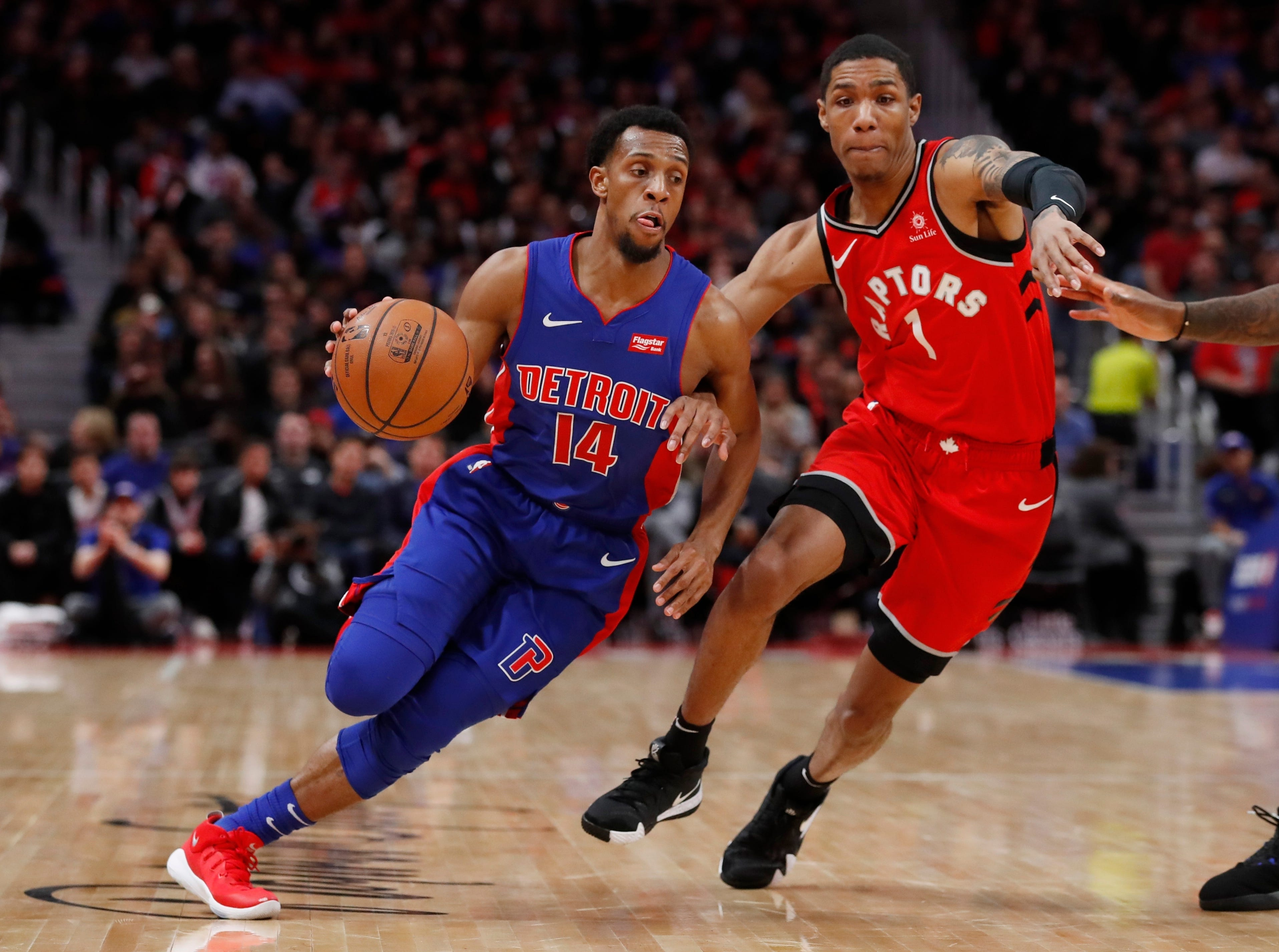 Detroit Pistons guard Ish Smith (14) drives against Toronto Raptors guard Patrick McCaw (1) during the first half.