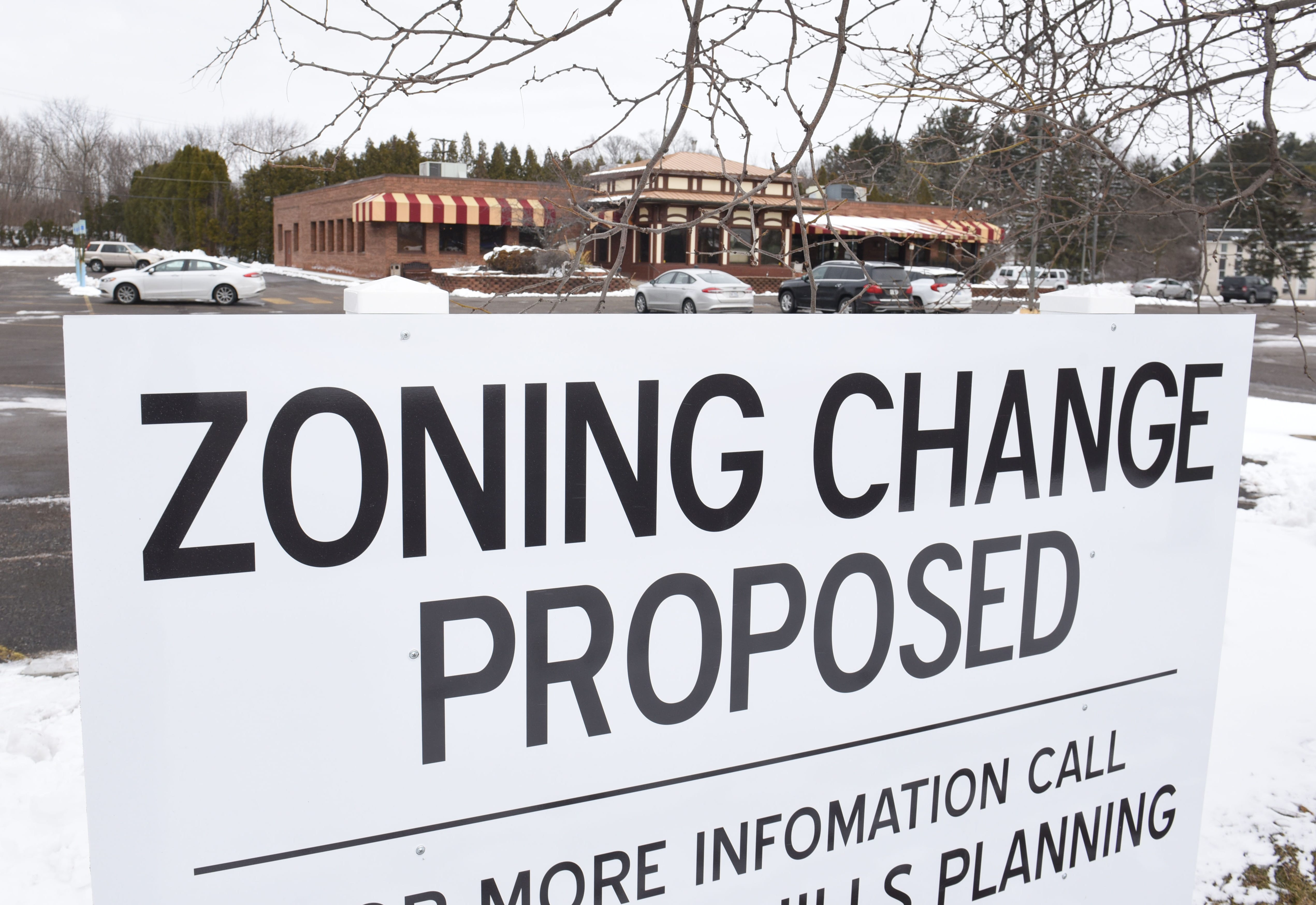 Owners John and Pete Ginopolis are finding that a zoning change sign has customers believing prematurely that Ginopolis' Bar-B-Q Smokehouse has closed. If all goes as planned, it will stay open until late spring or early summer.