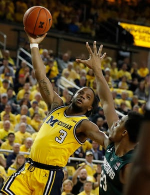 Michigan guard Zavier Simpson (3), shown here against Michigan State, made four skyhooks against Maryland.
