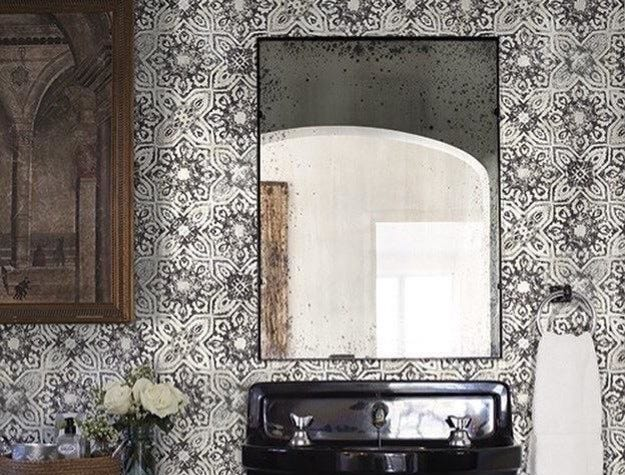 A bathroom can be a bit blah without a wow factor like this York Patina Vie Vintage Farmhouse Gray Fatima Mosaic Tiles Wallpaper, available through houzz.com.