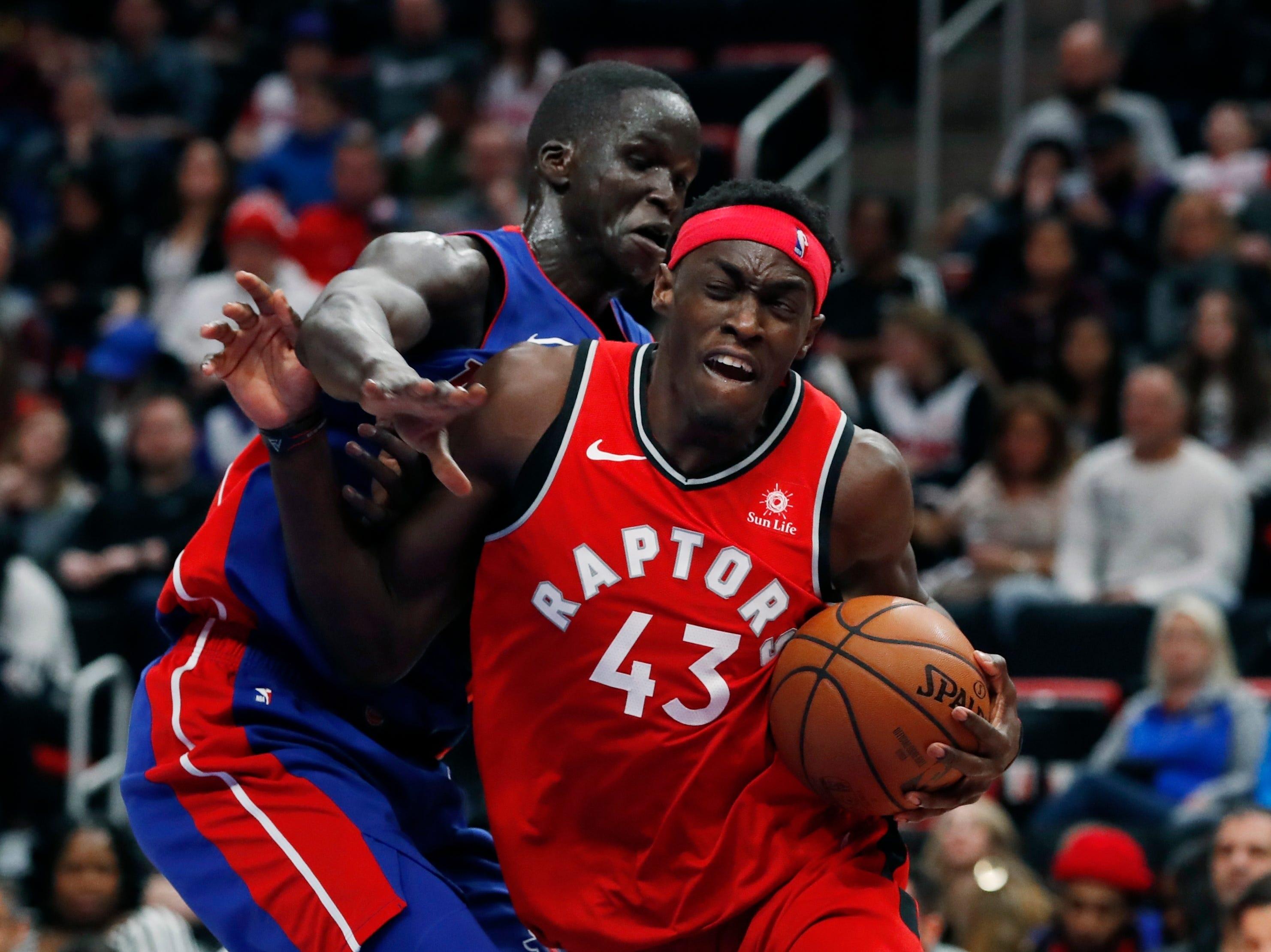 Toronto Raptors forward Pascal Siakam drives on Detroit Pistons forward Thon Maker rebounds during the second half.