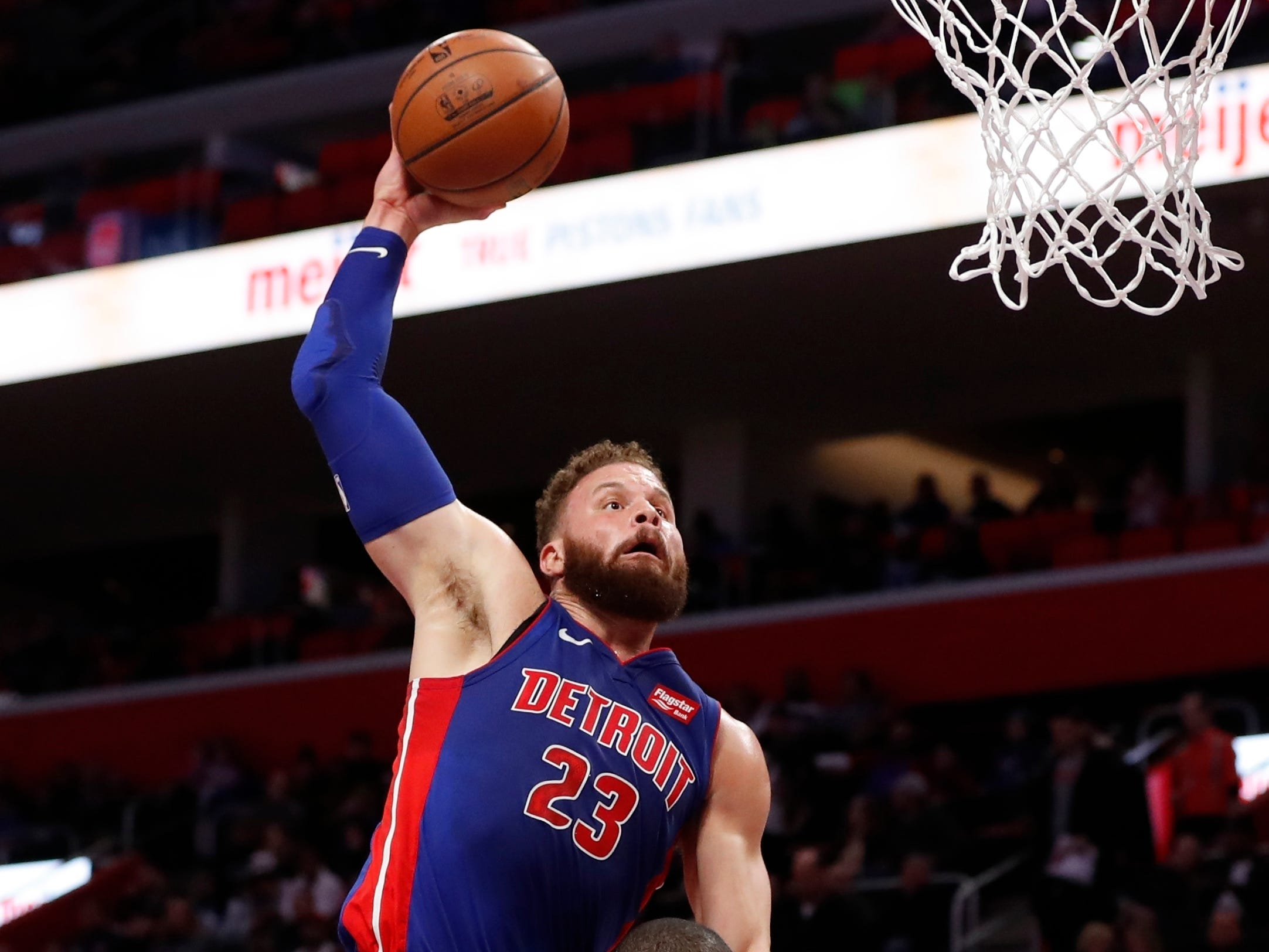Detroit Pistons forward Blake Griffin (23) goes for a dunk over Toronto Raptors center Serge Ibaka (9) during the first half of an NBA basketball game, Sunday, March 3, 2019, in Detroit.