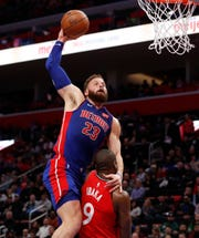 Detroit Pistons forward Blake Griffin (23) goes for a dunk over Toronto Raptors center Serge Ibaka (9) during the first half Sunday. Griffin finished with 27 points in Detroit's 112-107 OT win.