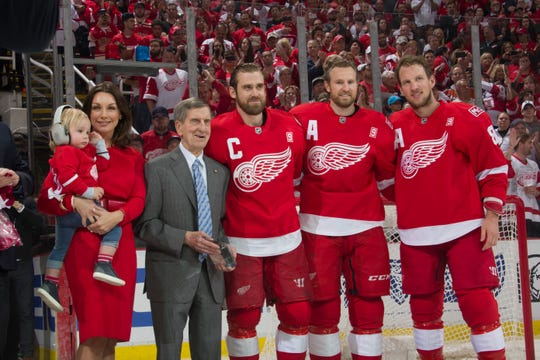 (From left) Emma Andersson, Love Zetterberg, Ted Lindsay, Henrik Zetterberg, Niklas Kronwall, and Justin Abdelkader take part in a pre-game ceremony honoring Henrik Zetterberg for his 1000th game.  April 9, 2017.