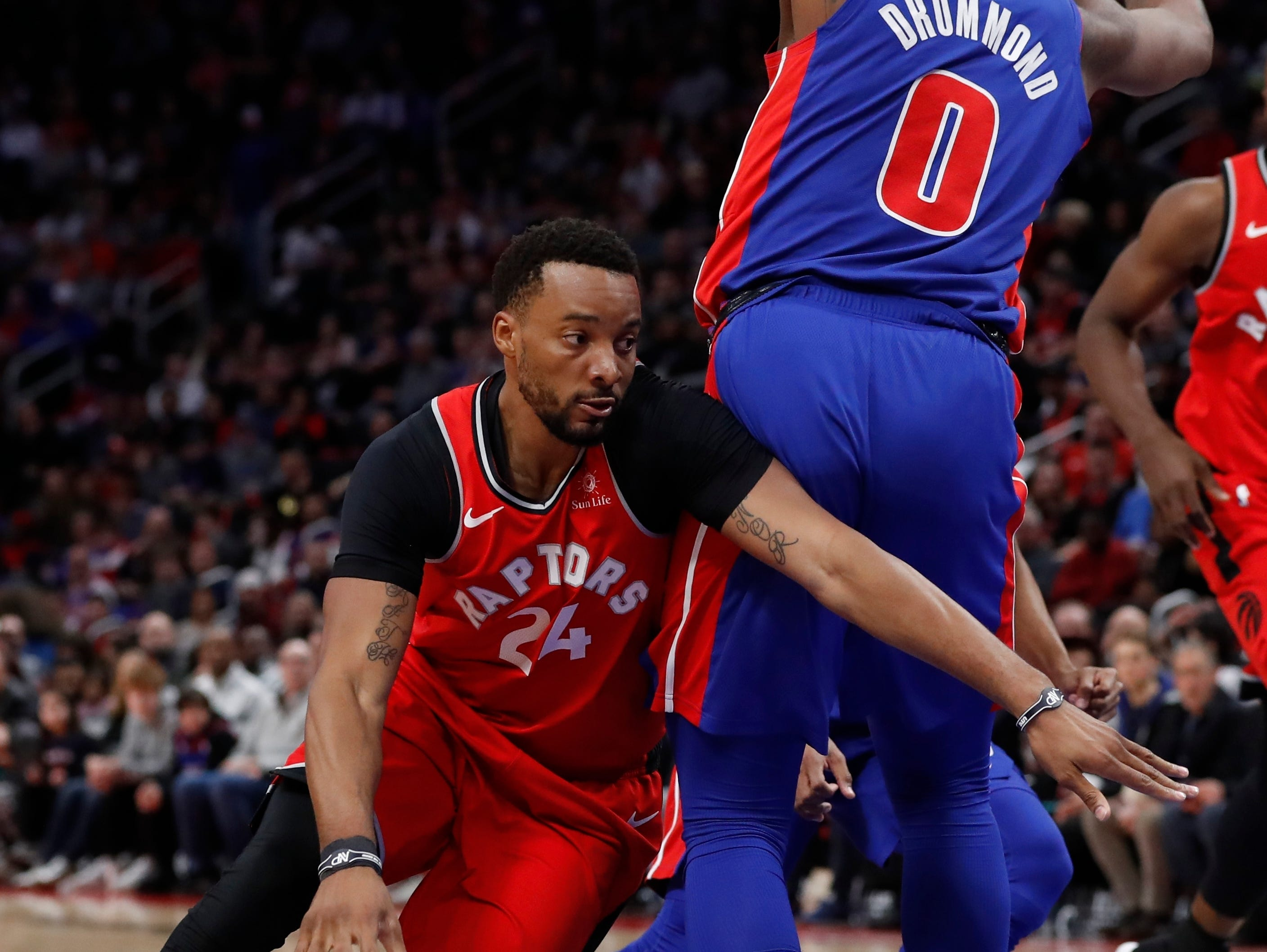 Toronto Raptors forward Norman Powell drives around Detroit Pistons center Andre Drummond (0) during the second half.