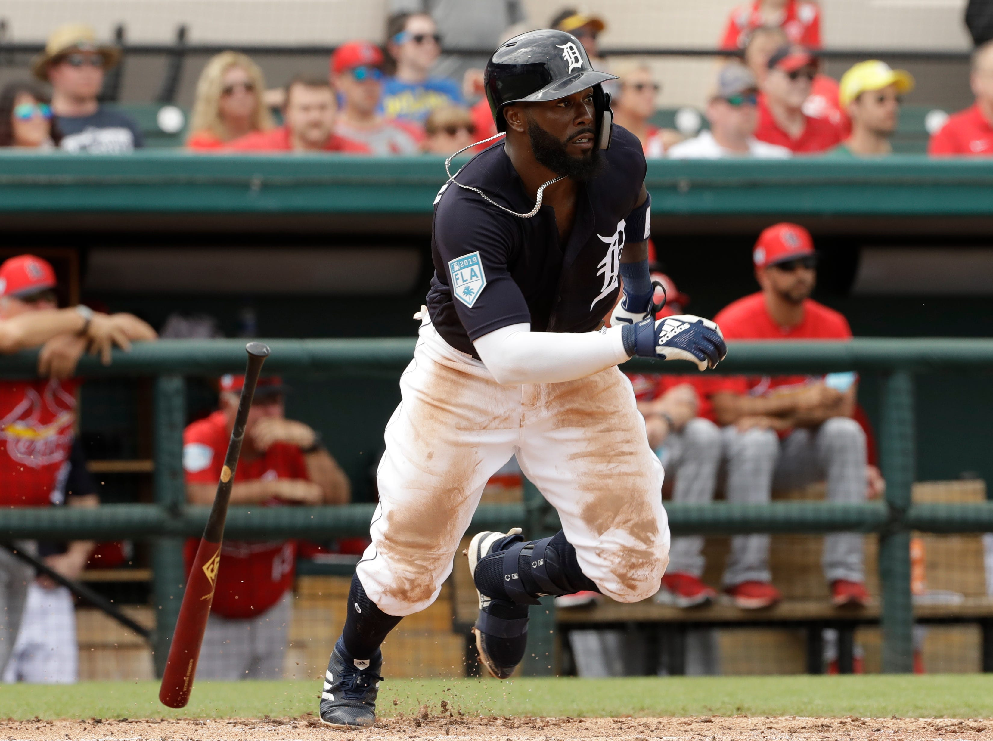 Detroit Tigers' Josh Harrison singles off St. Louis Cardinals starting pitcher Adam Wainwright during the third inning.