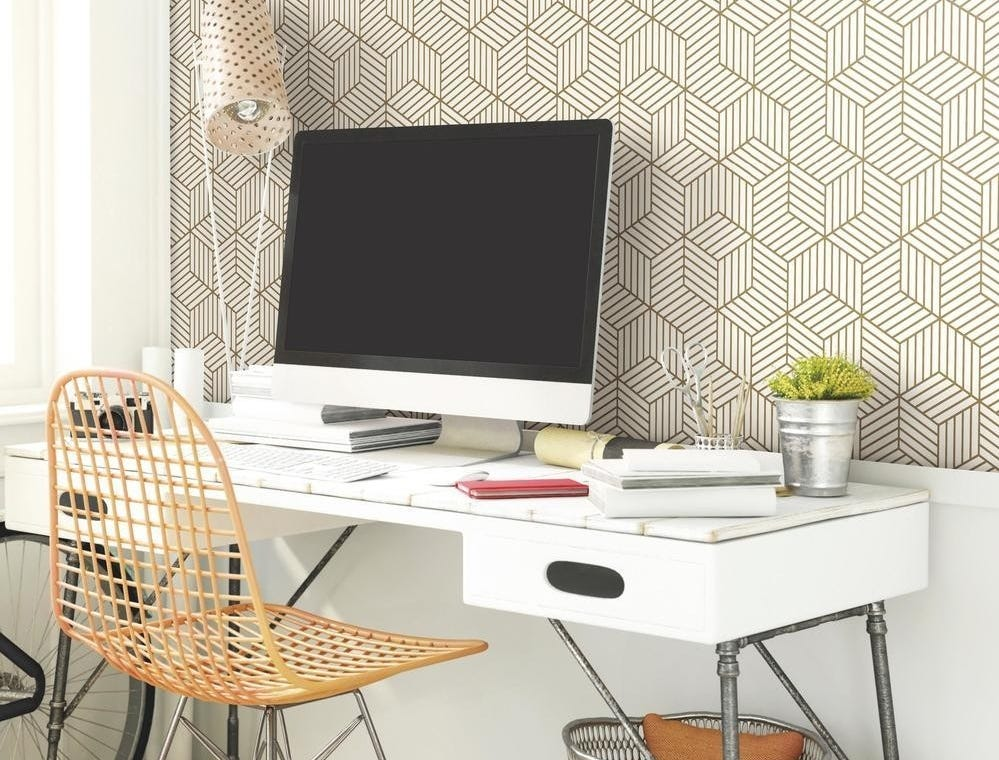 If you spend a lot of time in your home office, make it your favorite place to be with some updates like this Geometric Gold Hexagon Peel and Stick Mid-Century Modern Wallpaper available through houzz.com.