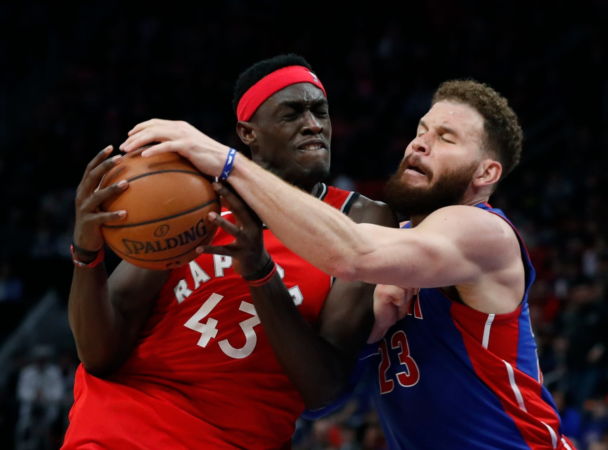 Detroit Pistons forward Blake Griffin knocks the ball away from Toronto Raptors forward Pascal Siakam (43) during the second half.