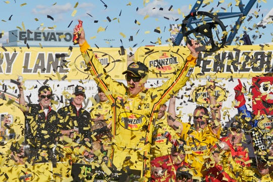 Joey Logano celebrates his first place victory of the Pennzoil 400 race Sunday at Las Vegas Motor Speedway.
