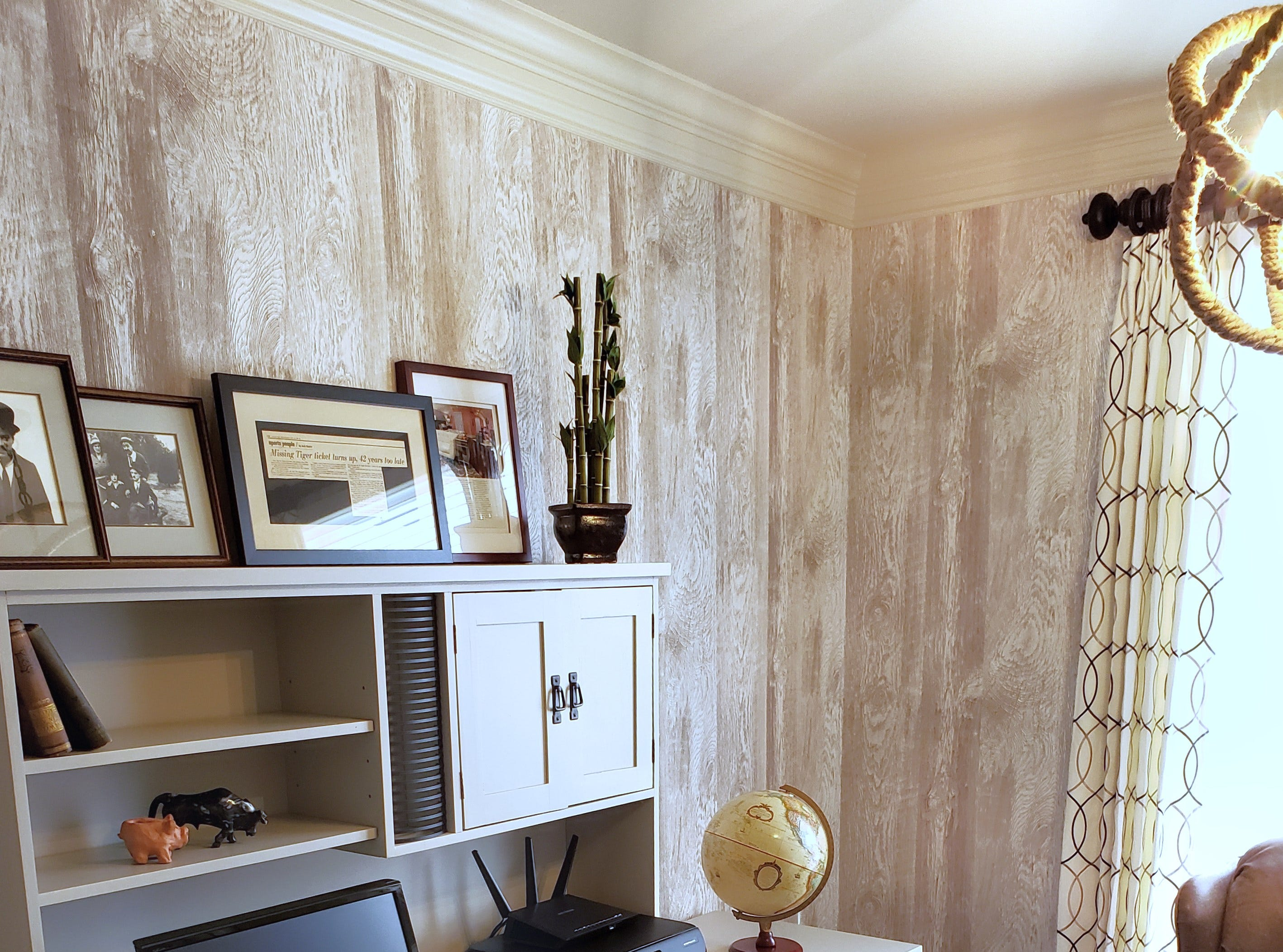 An extensive remodel may not be needed when a makeover will do. That was the case for Patricia Warner's home office that got some fresh updates, including new draperies and wallpaper with a faux rustic barn wood finish. Painting the office furniture gave the space a brighter feel.