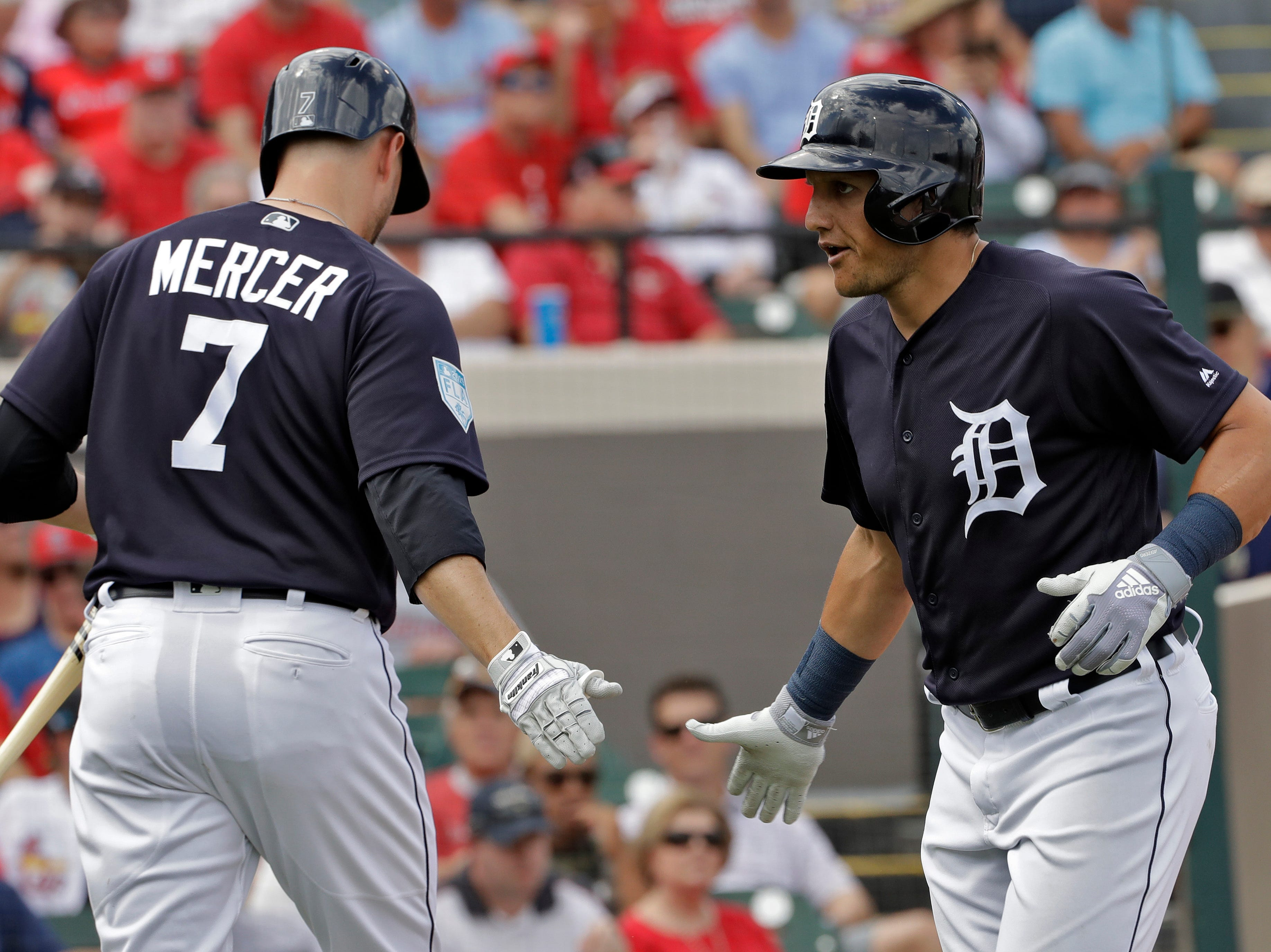 Detroit Tigers' Mikie Mahtook, right, celebrates with Jordy Mercer after hitting a home run off St. Louis Cardinals starting pitcher Adam Wainwright during the second inning.