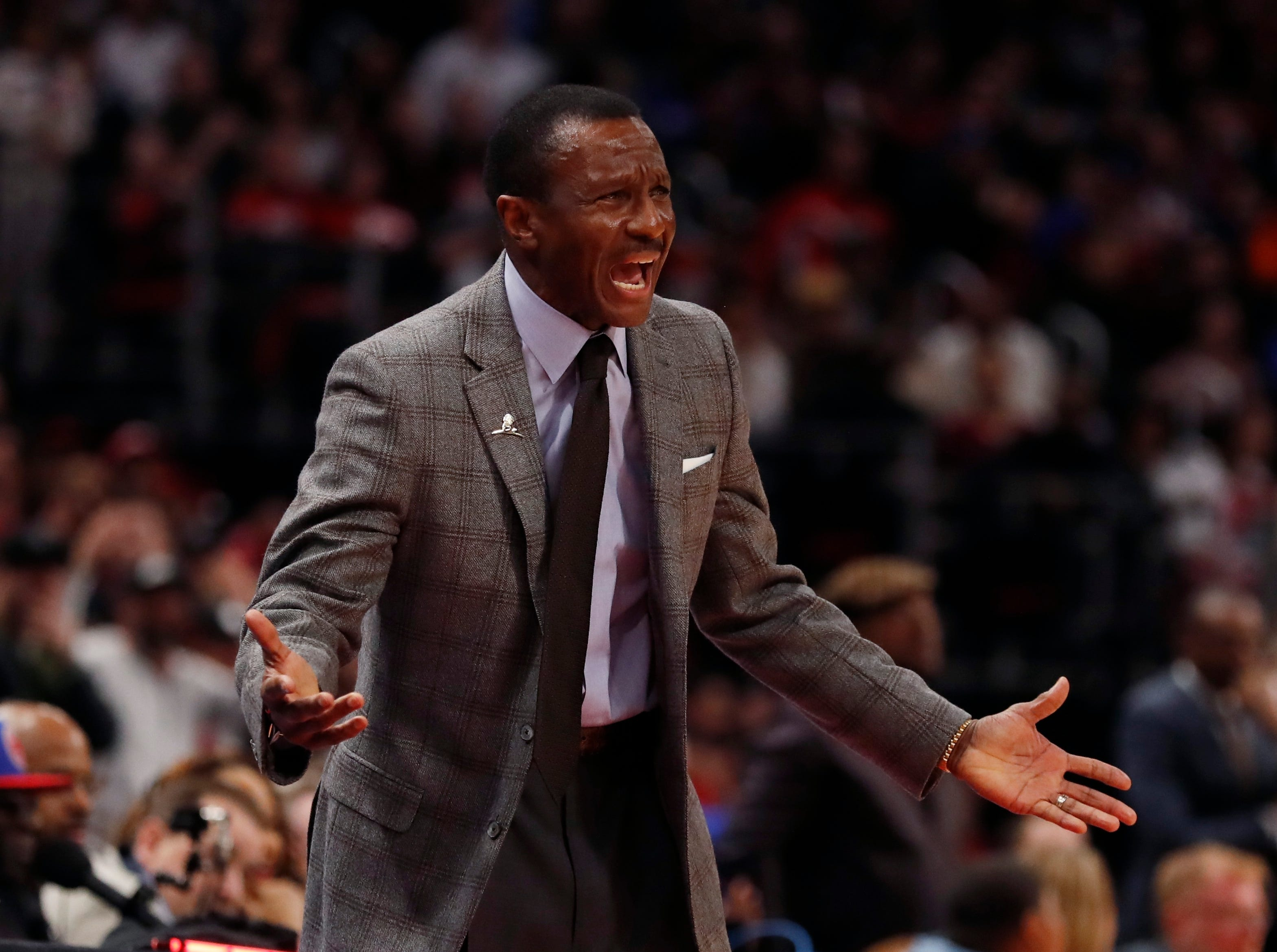 Detroit Pistons head coach Dwane Casey reacts after a call during the second half.