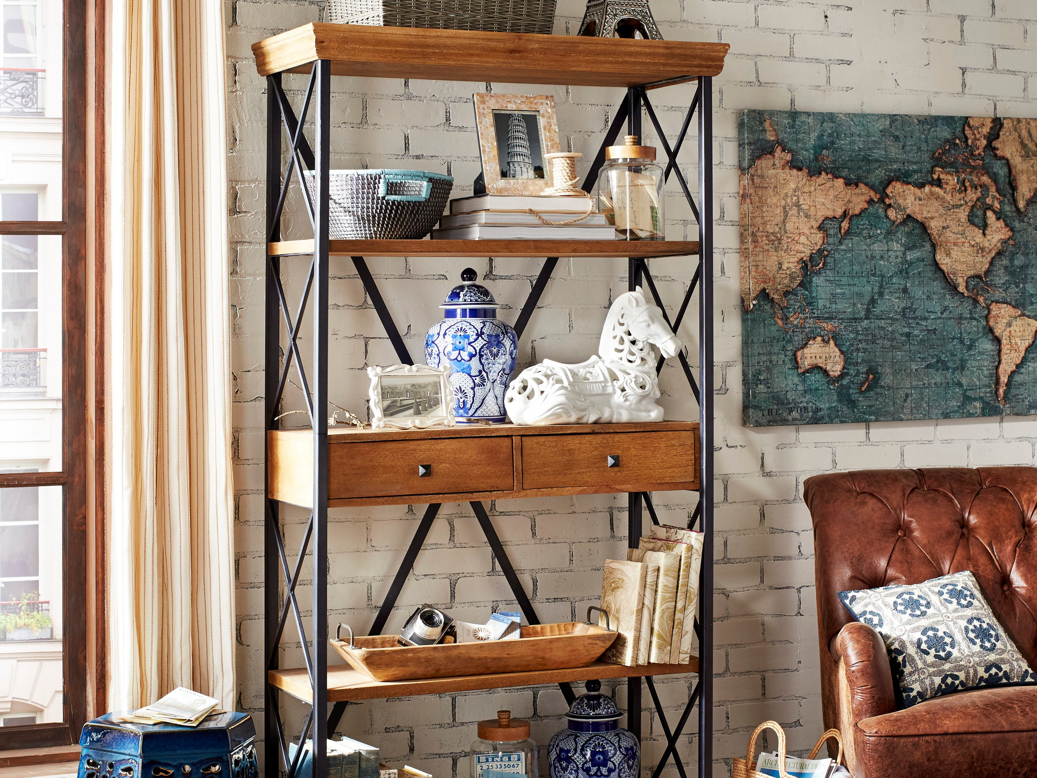 Blue and white collectibles like these ginger jars from Pier 1 Imports are showcased in these bookshelves.