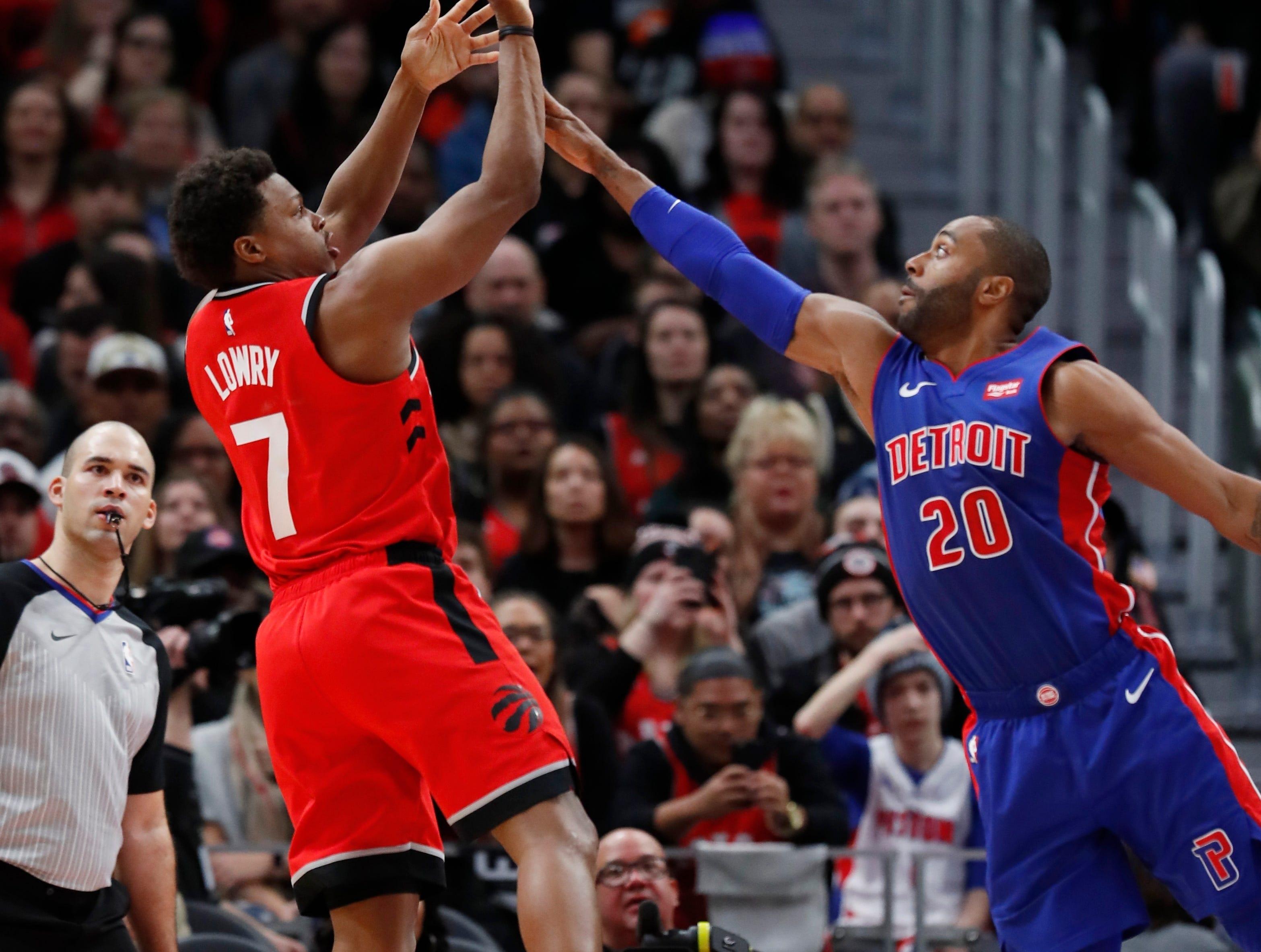 Toronto Raptors guard Kyle Lowry (7) shoots as Detroit Pistons guard Wayne Ellington (20) defends during the first half.