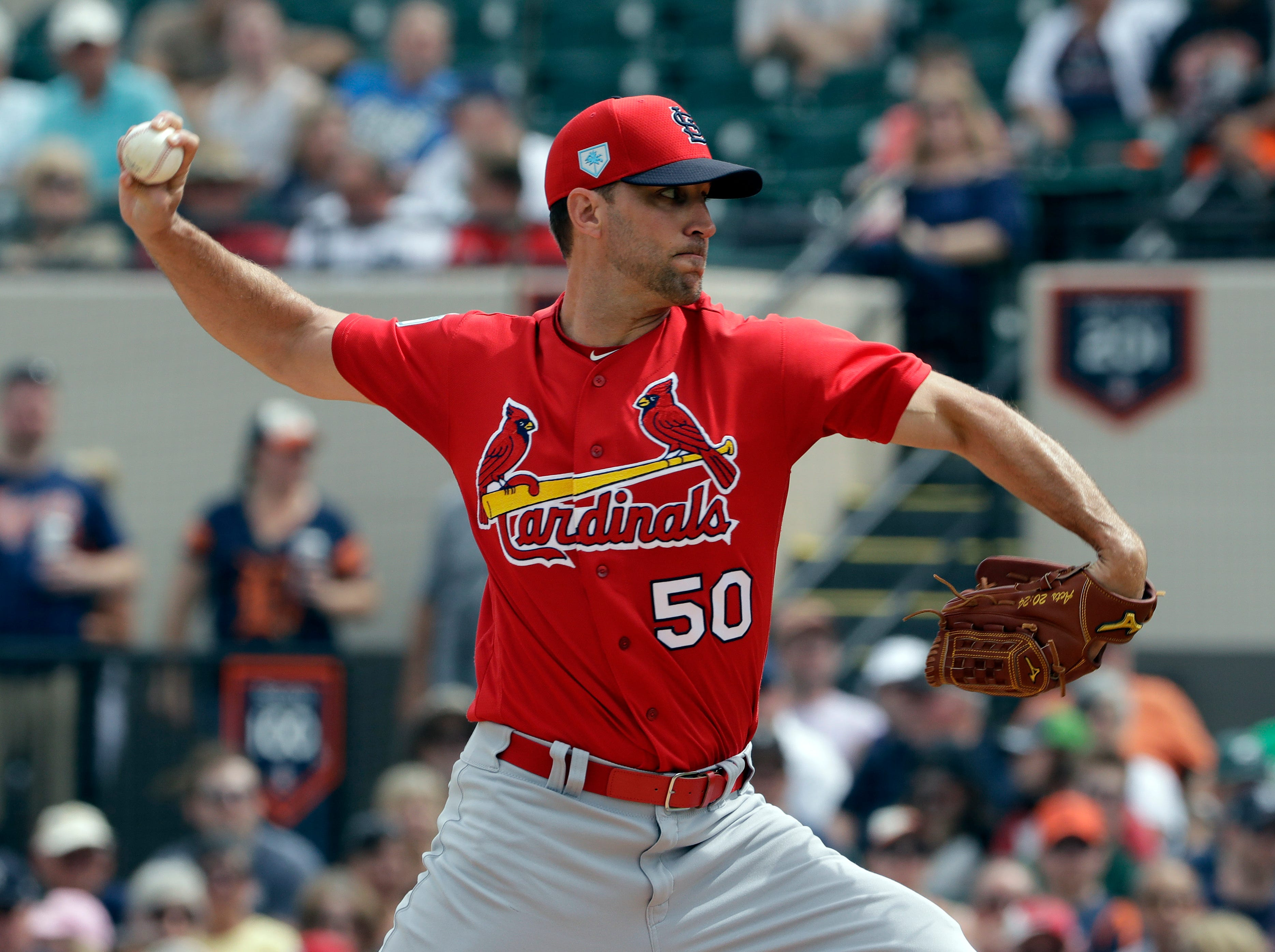 St. Louis Cardinals starting pitcher Adam Wainwright goes into his windup against the Detroit Tigers during the first inning.
