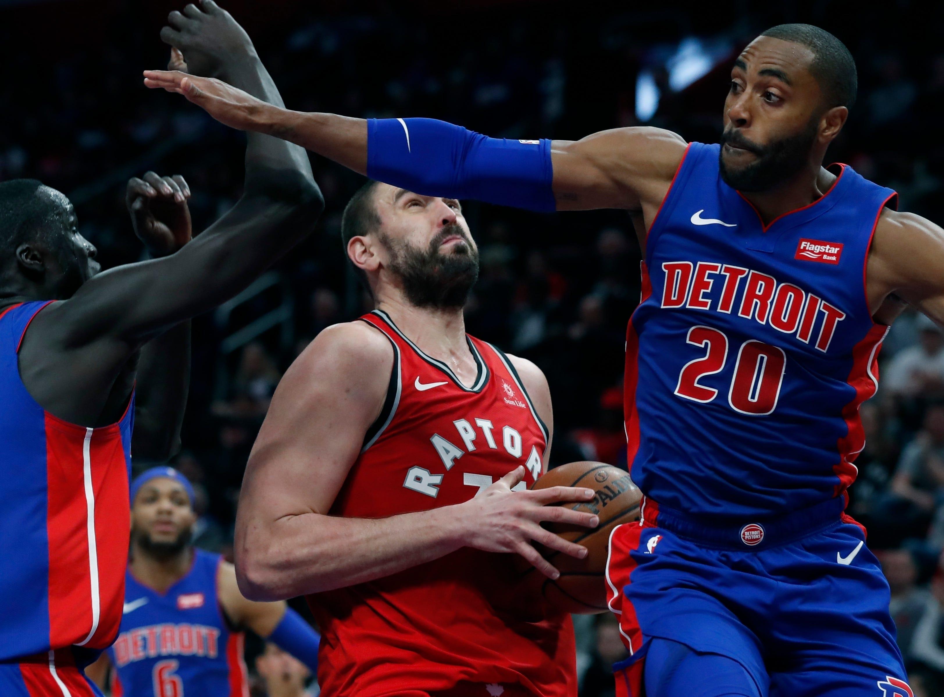 Toronto Raptors center Marc Gasol (33) looks to shoot as Detroit Pistons forward Thon Maker (7) and guard Wayne Ellington (20) defend during the second half.