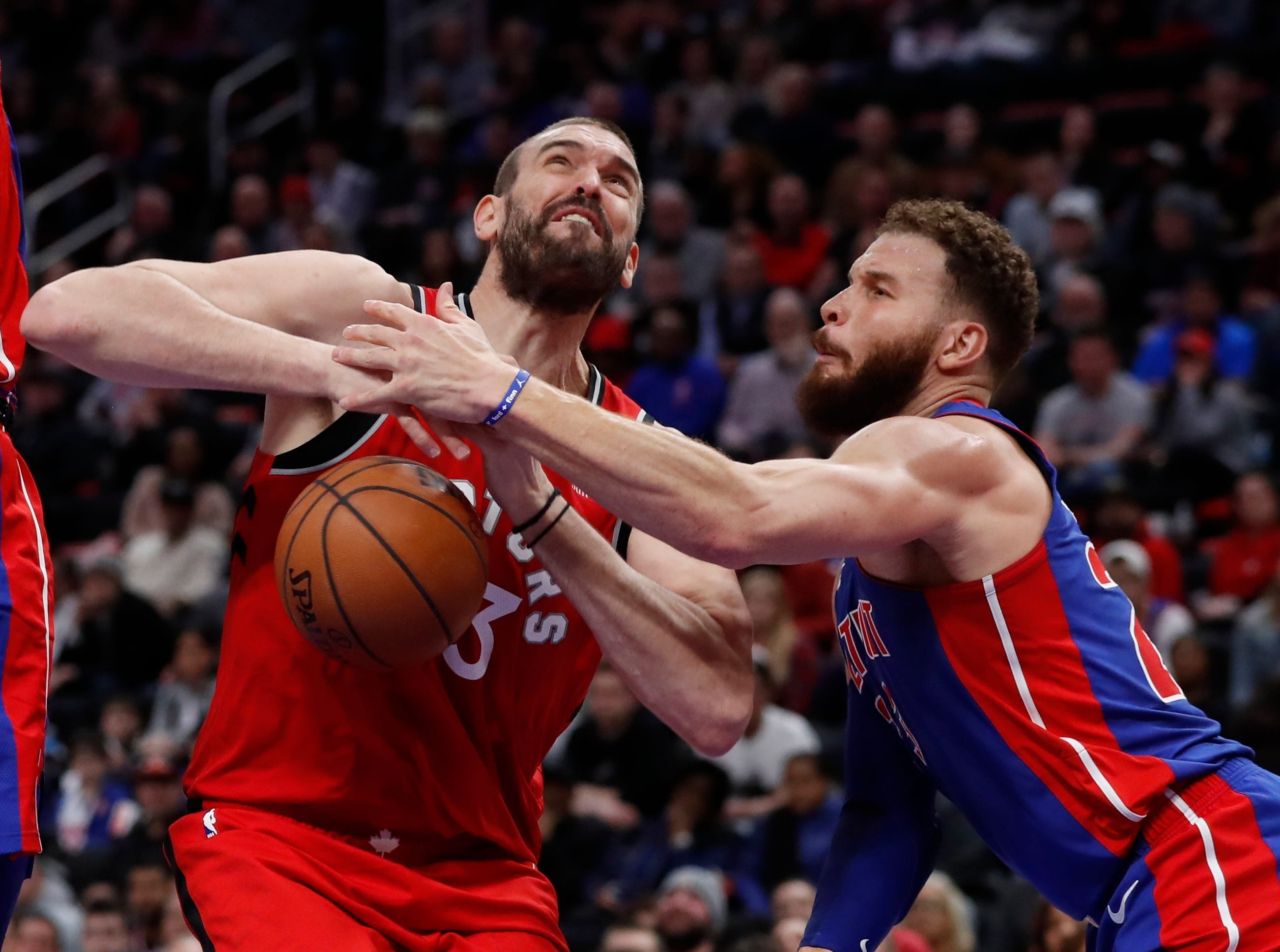 Detroit Pistons forward Blake Griffin knocks the ball away from Toronto Raptors center Marc Gasol (33) during the second half.