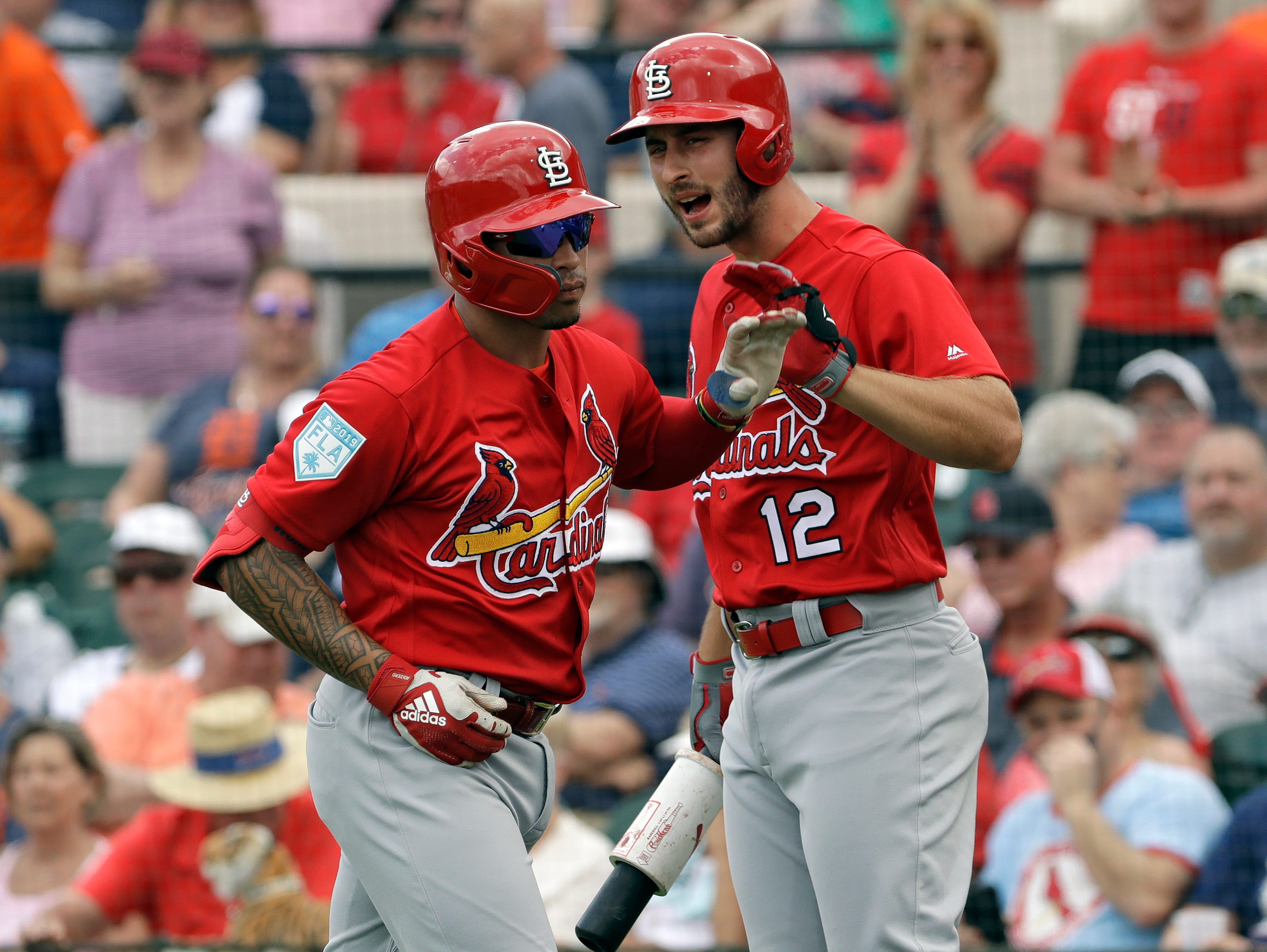 St. Louis Cardinals' Kolten Wong, left, celebrates his home run off Detroit Tigers starting pitcher Michael Fulmer with Paul DeJong  (12) during the first inning.