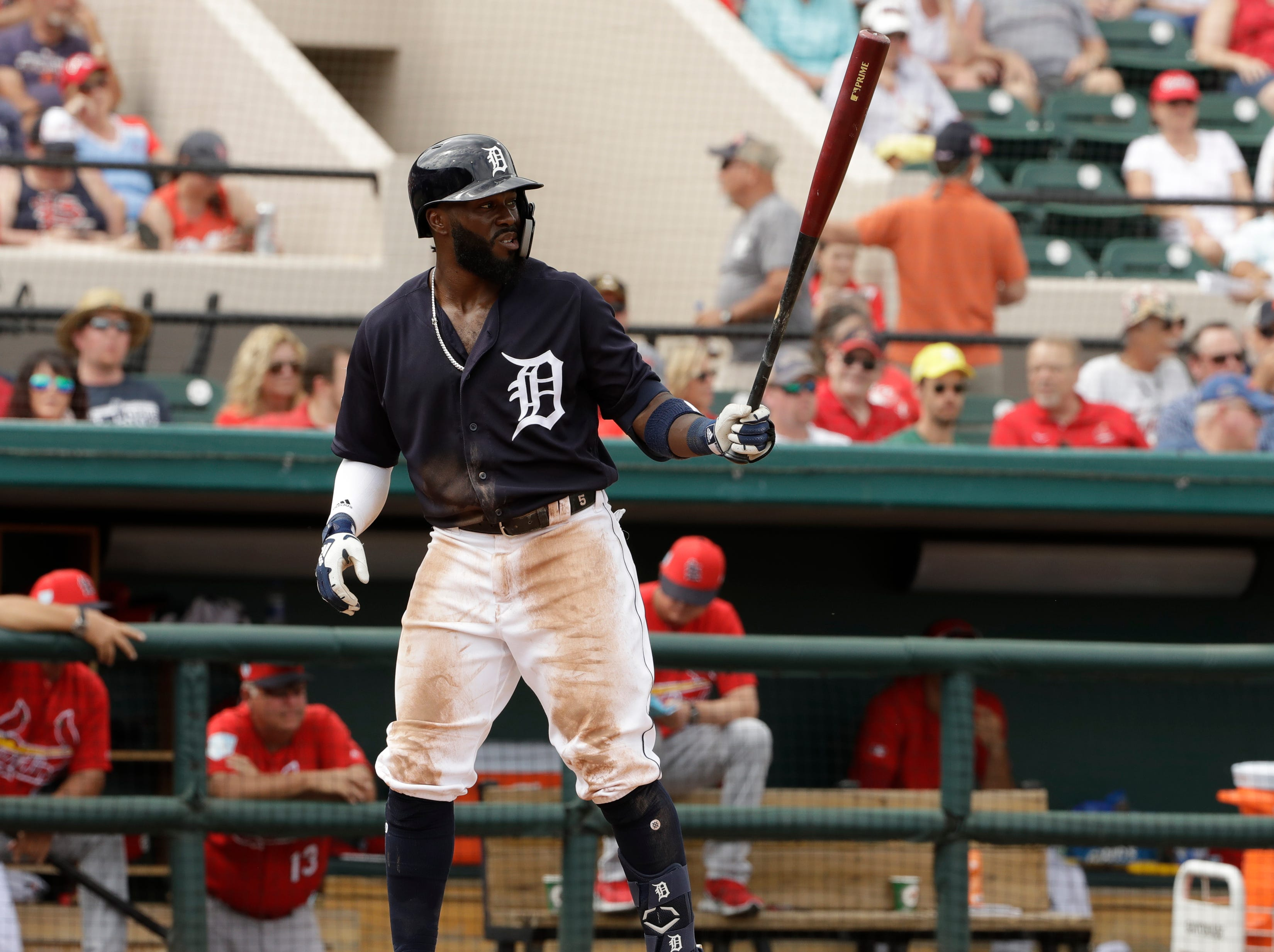 Detroit Tigers' Josh Harrison bats against the St. Louis Cardinals during the third inning.