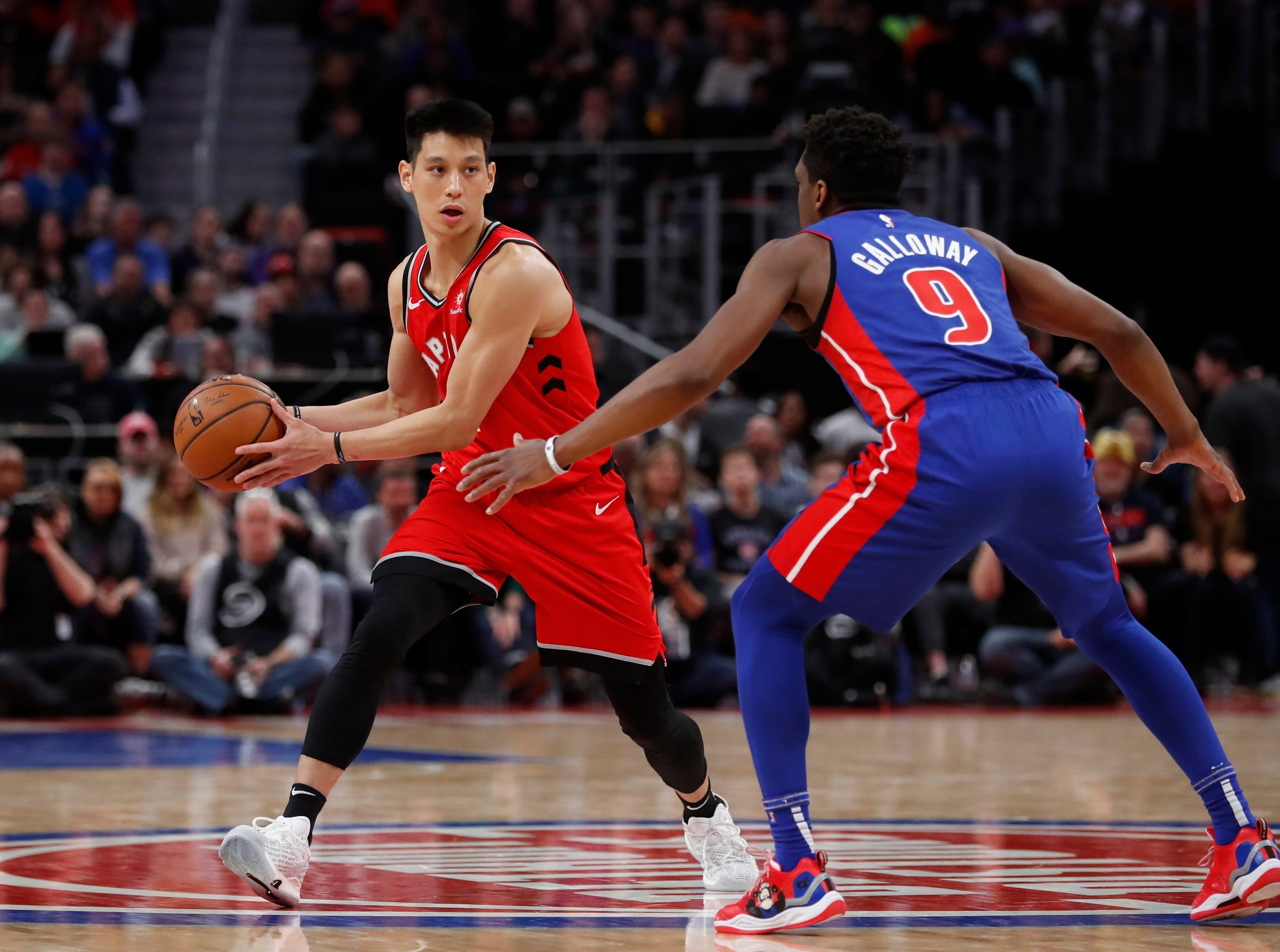 Toronto Raptors guard Jeremy Lin looks to pass around Detroit Pistons guard Langston Galloway (9) during the second half.